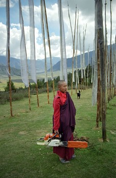 Monk with Chainsaw, Phobjikha Valley, Bhutan