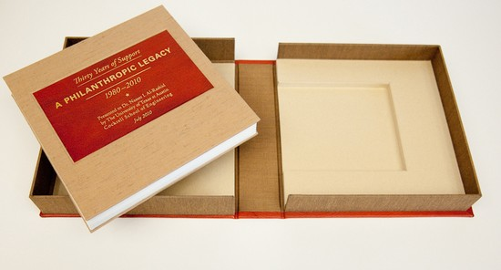 2L-18. Accordion book with leather label