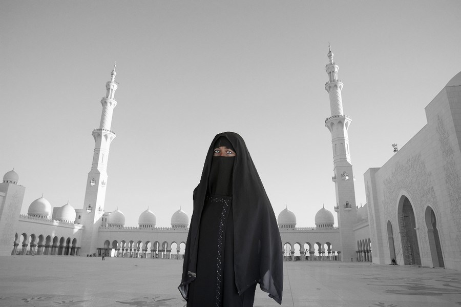 Muslim Woman in Mosque Courtyard