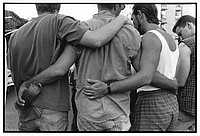AIDS activists comforting one another, NYC 1993