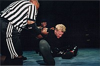 Iceman John Black torturing Johnny Dynamite