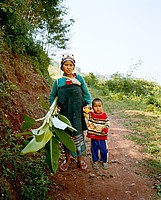 Akha mother with banana leaves