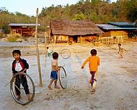 Khamu kids rolling tires